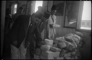 Egyptian customs officials examine parcels at Maadi camp, Egypt