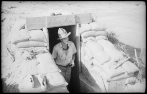 An officer emerging from his dugout in the Western Desert