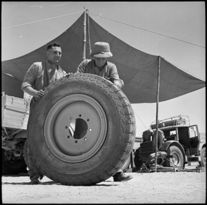 Showing large size of tyre off captured enemy truck, Egypt