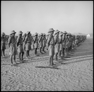 Members of Maori Battalion lined up watching concert party entertaining King of Greece, Helwan