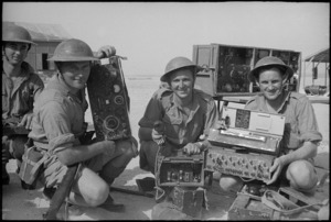 Members of NZ Divisional Signals with equipment brought out from Greece