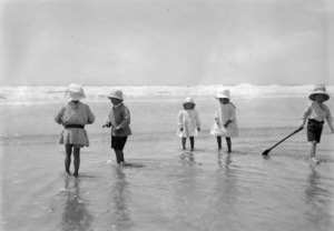 A group of children playing at the seaside