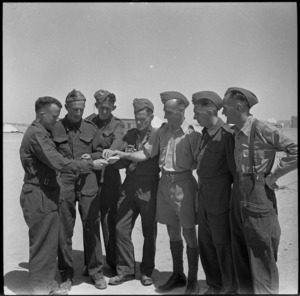 Group of repats from Italy experiencing decent cigarettes for a change - Photograph taken by M D Elias