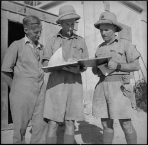 Officers of New Zealand Railway Operating Unit work out control schedules in the Western Desert, World War II