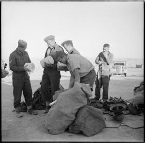 NZ troops collecting parcels from advanced post office after withdrawl from Libyan battle, World War II