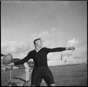 NZEF winger McAneny throwing in rugby ball at match in Alexandria, Egypt