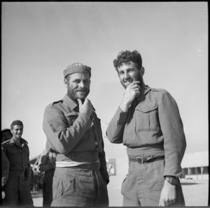 Two New Zealand soldiers back at Base Camp display beards grown during imprisonment in Libya - Photograph taken by M D Elias