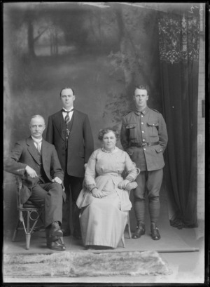 Studio unidentified family portrait, elderly parents with younger WWI soldier son with stirrups and older son with striped tie and greenstone watch chain pendant, Christchurch