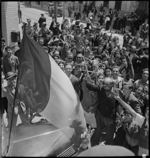 Population of Tunis demonstrating with French flag, World War II - Photograph taken by M D Elias