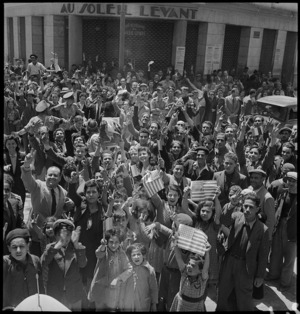 Population of Tunis demonstrating with American flags, World War II - Photograph taken by M D Elias
