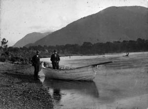 D J McKenzie in his boat, Hollyford River, Otago