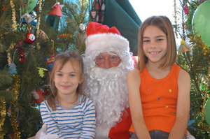 Photographs of children sitting with Santa Claus 2003, Greymouth