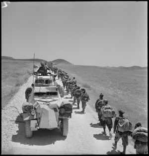 Italian POWs pass armoured car on their march to POW cages - Photograph taken by M D Elias