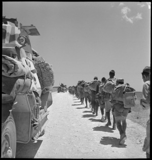 Armoured car passes Italian POWs marching back - Photograph taken by M D Elias
