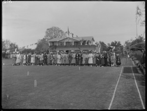 Opening of the Kaitoa Bowls and Croquet Club, with female members lined up for photo in front of club rooms, Hastings, Hawke's Bay District