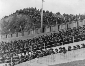 Spectators watching a rugby game between Wellington and Great Britain at Athletic Park, Wellington