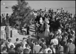 Crowd of patients around Christmas tree at 2 NZ General Hospital, Egypt - Photograph taken by W Timmins
