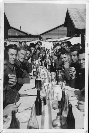 Christmas dinner in the open at NZ Base Reception Unit Maadi Camp, World War II - Photograph taken by H G Witters