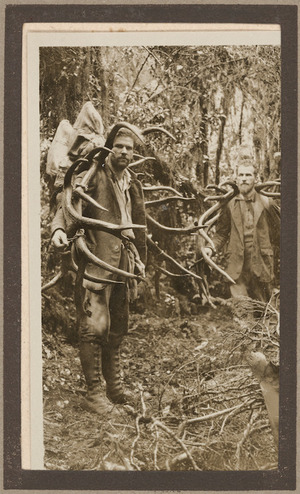 Guy and Leslie Murrell carrying two wapite heads