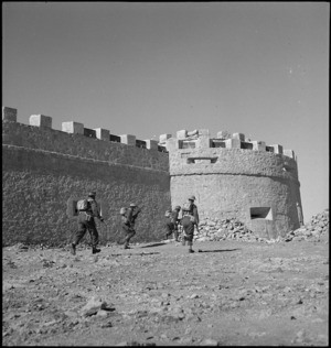 NZ infantry attacking Italian fort at Cyrenaica, Libya - Photograph taken by M D Elias