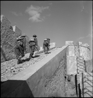 Troops climbing up to Italian fort's ramparts at Cyrenaica, Libya - Photograph taken by M D Elias