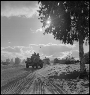 British armoured car advances on Tripoli with NZ Division, World War II - Photograph taken by H Paton
