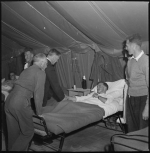 New Zealand Defence Minister, Hon Frederick Jones, meeting a patient at 2 NZGH, Egypt - Photograph taken by S Wemyss