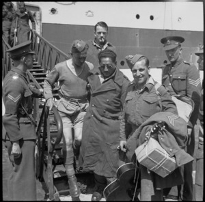 NZ sergeant and blind Maori soldier coming ashore at Alexandria, World War II - Photograph taken by G R Bull