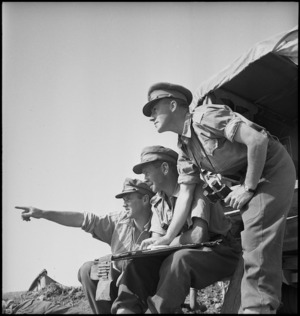Artillery officers discussing a problem in Tunisia, World War II - Photograph taken by M D Elias