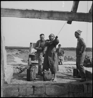 Local Tunisian assists New Zealander to draw water from well in Tunisia - Photograph taken by M D Elias