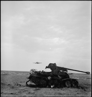 Tank buster aircraft and a shot up anti tank gun in Tunisia, World War II - Photograph taken by M D Elias