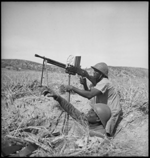Senegalese troops with Free French forces operating machine gun in Tunisia, World War II - Photograph taken by M D Elias