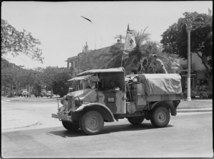 Transport of the New Zealand Division passing through Maadi, Egypt, at the end of North African campaign, World War II - Photograph taken by H Paton