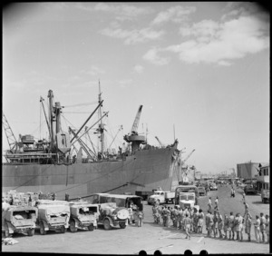 Drivers of NZ advance party trucks lining up for lunch on Alexandria wharf, World War II - Photograph taken by M D Elias