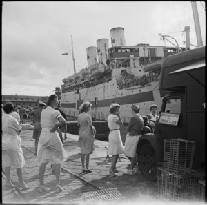 Red Cross workers with mobile canteen on the wharf at Alexandria as repatriated POWs come ashore from the hospital ship Tairea - Photograph taken by George Robert Bull