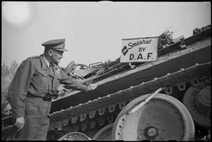 Lieutenant General Sir Bernard Freyberg beside notice 'Smashed by Desert Air Force' he placed on German tank, Italy - Photograph taken by G Kaye