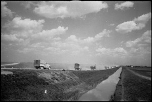 NZ Division vehicles on their advance through flat country near the River Po, Italy, World War II - Photograph taken by George Kaye