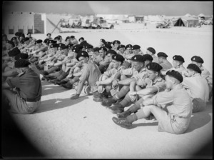 Members of Divisional Cavalry seated during church parade at Maadi Camp, World War II - Photograph taken by G Kaye