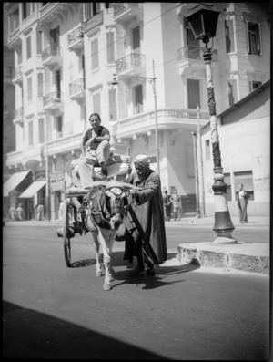 Street scene in Cairo showing local men and cart - Photograph taken by George Kaye