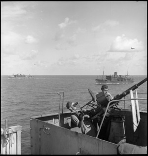Gun crew at anti aircraft stations on transport carrying members of 2 NZ Division to Italy, World War II - Photograph taken by M D Elias