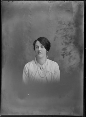 Studio upper torso unidentified portrait of a young woman in a lace collar blouse with cameo brooch and pearl necklace, Christchurch