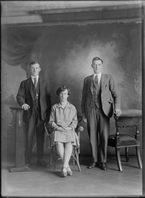 Studio portrait of an unidentified woman and young two men, probably Christchurch district