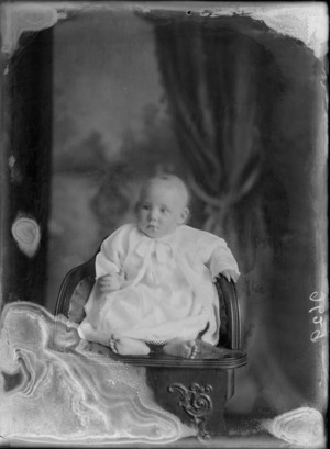 Studio portrait of unidentified baby, wearing a gown, probably Christchurch district