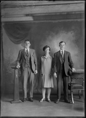 Studio portrait of an unidentified woman and two young men, probably Christchurch district