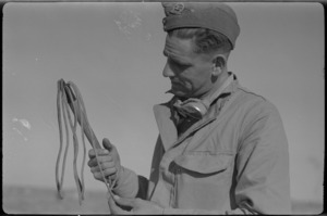 NZ soldier examines a captured whip during 2nd Libyan Campaign
