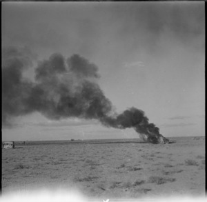 Trucks burning following air attack during the advance into Libya, World War II