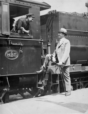 Joseph Gordon Coates speaking with the driver of locomotive Ab825 at Auckland Railway Station