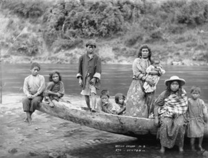 Unidentified group sitting on the prow of a canoe