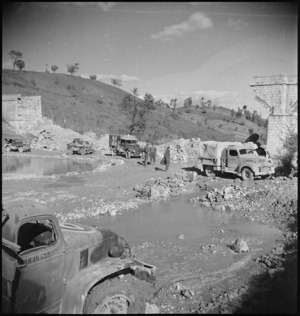 Transport crossing a deviation made by NZ Engineers close to Sangro River in Italy, World War II - Photograph taken by George Kaye
