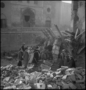 Italian families searching among the ruins of their homes in Atessa, Italy, World War II - Photograph taken by George Kaye